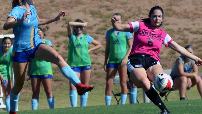 New Mexico State's Rebecca Mazzie (6) gets a shot off as the Aggies took on Cal State Bakersfield Friday afternoon at the NMSU Soccer Complex.