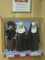 A few of the nun dolls on display at the Cross in the Woods shrine in Indian River.