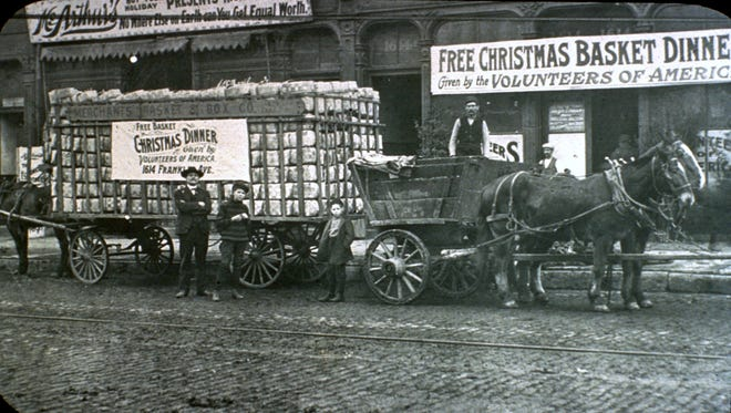 In Lansing, Volunteers of America Christmas meals were being delivered as early as 1917. This photo is believed to be from 1903 in St. Louis, Missouri.