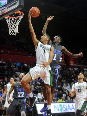 Mike Cubbage lays the ball up while playing for Winslow against Teaneck at Rutgers University in New Jersey in this 2015 file photo.