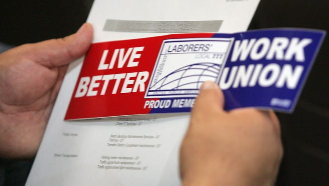 A pro-union bumper sticker that accompanied the outlines of a proposed measure to outsource city labor jobs to private contractors in 2010 in Phoenix.