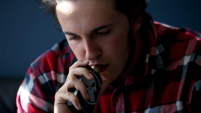 A customer smokes an E-Cigarette at Digital Ciggz in San Rafael, California.