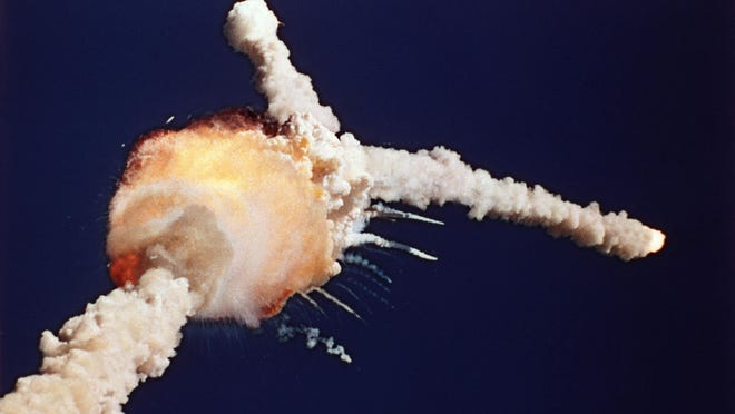 The Space Shuttle Challenger explodes shortly after lifting off from Kennedy Space Center on Jan. 28, 1986. All seven crew members died in the explosion, which was blamed on faulty o-rings in the shuttle's booster rockets.