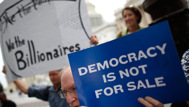 Supporters of overhauling campaign-finance rules demonstrate outside the U.S. Capitol in 2014.
