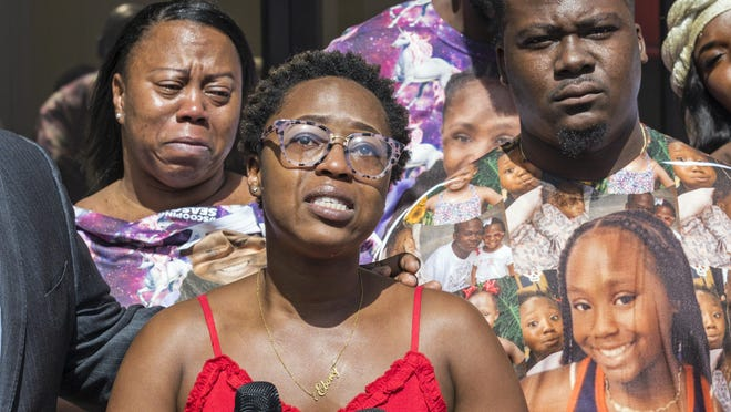 Ebony Morgan describes seeing her daughter Re'Asia Washington's decomposed body at Shawn Johnson Funeral and Cremation in Riviera Beach during a press conference Thursday, Feb. 13, 2020.  The family says the funeral home mishandled the body of 11-year-old Re'Asia, who died of an asthma attack Jan. 22.  Re'Asia's family has filed a complaint with the state, saying the funeral home failed to preserve the girl's remains and allowed her body to decay in the days before a planned memorial service. At right is Reginald Washington, Re'Asia's father.