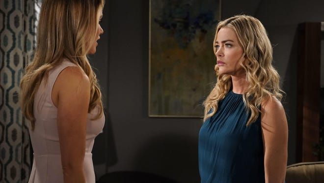 """Katrina Bowden, left, and Denise Richards appear in a scene from """"The Bold and the Beautiful"""" in 2019. The series is one of the first U.S. productions to resume filming."""