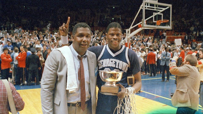 In this March 9, 1985, file photo, Georgetown NCAA college basketball head coach John Thompson poses with player Patrick Ewing after Georgetown defeated St. John's in the Big East Championship in New York.