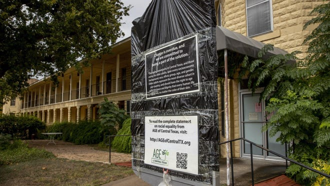 AGE of Central Texas, which owns the Cedar Street building that formerly was the Texas Confederate Woman's Home, has covered the historical marker at the property and has asked the Texas Historical Commission to remove it.