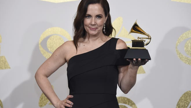 "Songwriter Lori McKenna, of Stoughton, poses in the press room with the award for best country song for ""Humble and Kind"" by Tim McGraw at the 59th annual Grammy Awards at the Staples Center on Sunday, Feb. 12, 2017, in Los Angeles."