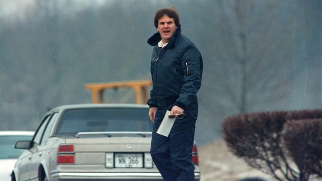 Former major league baseball player Pete Rose looks toward members of the media gathered outside the Marion Federal Prison after his release from the facility in Marion, Ill., Monday morning, Jan. 7, 1991. Rose will now report to a halfway house in Cincinnati. (AP Photo/James A. Finley)