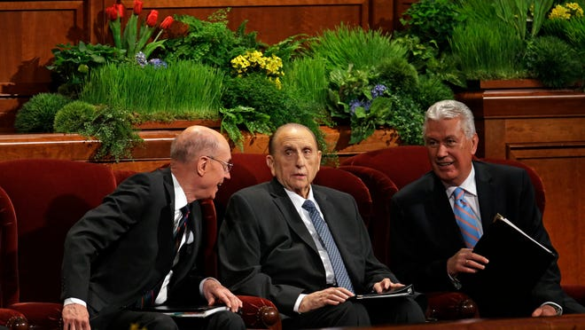 President Thomas S. Monson of The Church of Jesus Christ of Latter-day Saints, center, is flanked by President Henry B. Eyring, First Counselor in the First Presidency, left, and Dieter F. Uchtdorf, Second Counselor in the First Presidency during opening session of the two-day Mormon church conference April 4 in Salt Lake City. More than 100,000 Mormons descended on Salt Lake City for the faith's biannual conference to listen to spiritual guidance from leaders and to learn about church news.