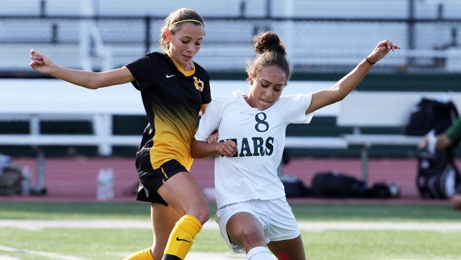 Mark R. Sullivan/staff photographer East Brunswick?s Victoria Constantin (right) competes with Piscataway?s Kaitlyn Zeeb during Tuesday?s girls  soccer game in Piscataway. Piscataway takes on East Brunswick in a girls varsity soccer game at East Brunswick High School on Tuesday September 27, 2016East Brunswick's # 8 Victoria Constantin (right) battles with Piscataway's # 12 (left) Kaitlyn Zeeb.
