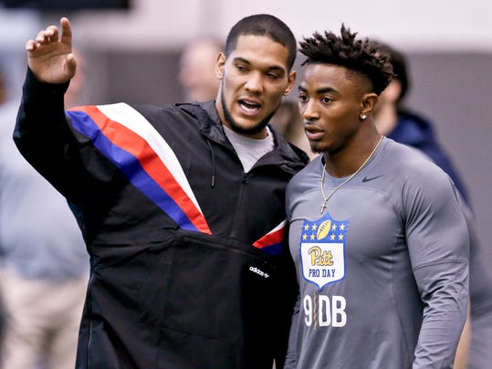 Pittsburgh Steelers running back and University of Pittsburgh alumnus James Conner, left, gives some direction to Pittsburgh defensive back Jordan Whitehead (9) before he runs the 40-yard dash during the NCAA football team's annual pro-day, Wednesday, March 21, 2018, in Pittsburgh. Pro Day is intended to showcase talent to NFL scouts for the upcoming draft. (AP Photo/Keith Srakocic)