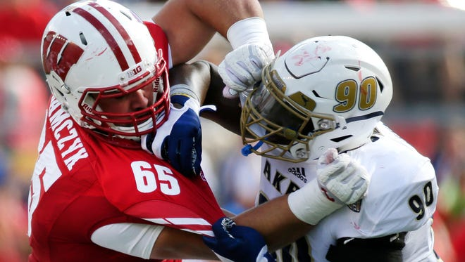 Wisconsin offensive lineman Ryan Ramczyk blocks Akron's Se'Von Pittman during their game early this season. Ramczyk announced he will enter this year's NFL Draft.