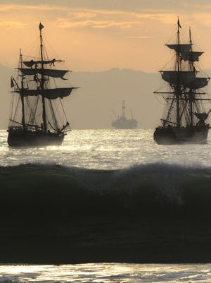 The Hawaiian Chieftain and Lady Washington, replicas of old sailing vessels, carry out a mock skirmish on an earlier visit to Ventura.