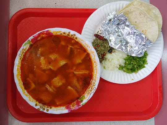 Menudo, a Mexican soup made with tripe, comes with all the fixings at Grullo's Fine Mexican Food in Mesa.