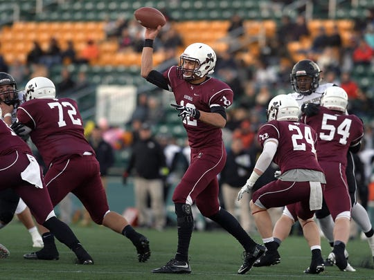 Aquinas quarterback Jake Zembiec throws from the pocket early in the Section V Class AA Football Championship.