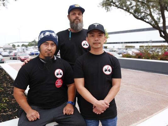 Tesla workers and the Model 3