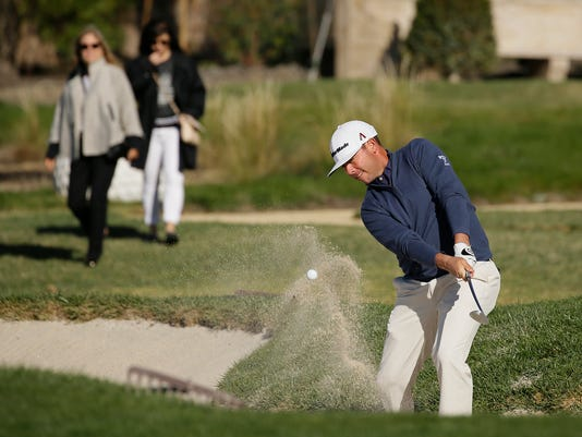 Chez Reavie hits out of a bunker onto the second green of the Pebble Beach Golf Links during the final round of the AT&T Pebble Beach National Pro-Am golf tournament Sunday, Feb. 11, 2018, in Pebble Beach, Calif. (AP Photo/Eric Risberg)