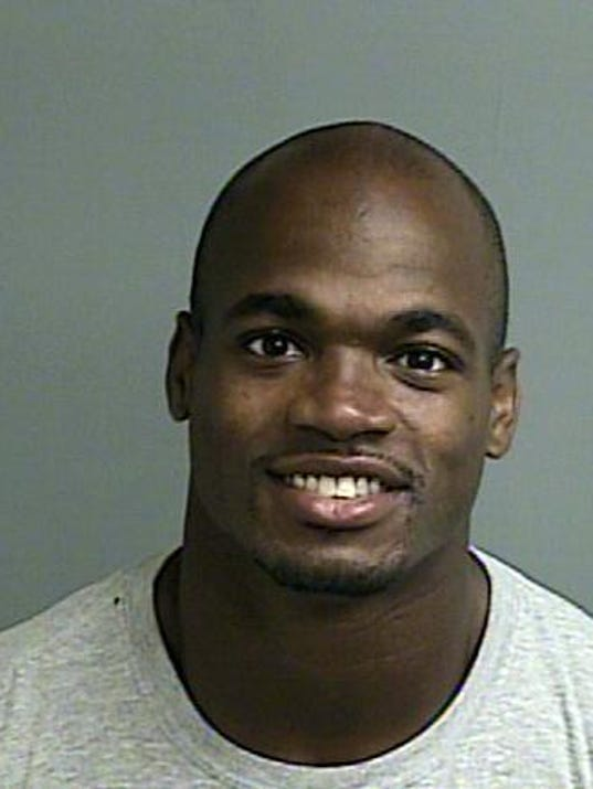This photo provided by the Montgomery County sheriff's office shows the booking photo of Adrian Peterson.  Peterson was indicted in Texas for using a branch to spank one of his sons and the Minnesota Vikings promptly benched him for their game Sunday, Sept. 14, 2014 against the New England Patriots. Peterson turned himself in early Saturday at a jail in Montgomery County, near Houston, where he has a home. He was processed and released.  (AP Photo/Montgomery County sheriff's office)