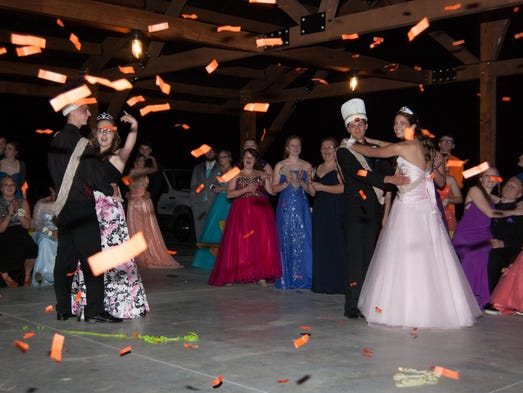 Confetti falls as the prom court couples dance at Fannett-Metal