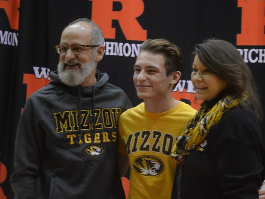 Richmond's Ike Khamis signed his National Letter of