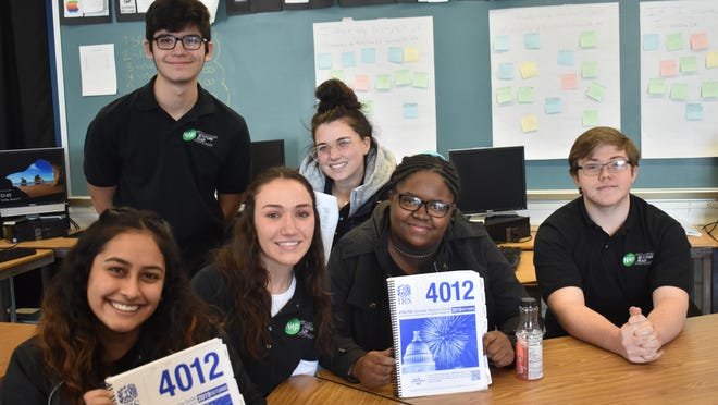 These Monticello High School students will be among those doing tax preparation for residents with income under $56,000 through the Volunteer Income Tax Assistance program this year. From left to right in front are Janvi Patel, Drew Taylor, Khalea Washington and Declan Lyons. In back are Eric Sanchez-Surman and Sydney Lemmerman.