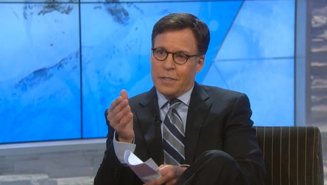 Screen grab of nbcolympics.com video 'Costas with Remnick, Posner on politically-charged Games' showing Bob Costas during interview with New Yorker editor David Remnick and Russian TV host Vladimir Posner.