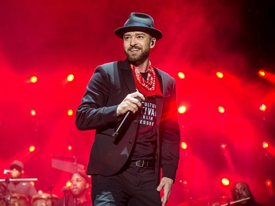 """FILE - In this Sept. 23, 2017 file photo, Justin Timberlake performs at the Pilgrimage Music and Cultural Festival in Franklin, Tenn. Timberlake previewed his new album """"Man of the Woods"""" Tuesday, Jan. 16, 2018, at a venue that was decorated with bushes and trees, and served ants coated in black garlic and rose oil and grasshoppers, showcasing the album's theme. Timberlake, who will headline next month's Super Bowl halftime show, worked again with his mega-producer Timbaland on the album. First single and album opener, """"Filthy,"""" debuted at No. 9 on the Billboard Hot 100 chart this week. (Photo by Amy Harris/Invision/AP, File) ORG XMIT: NYET290"""