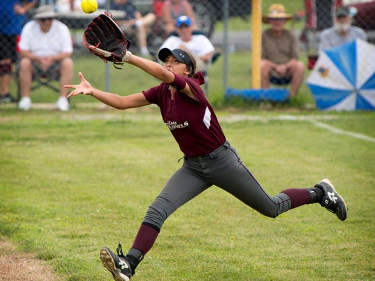 Henderson County's Lexus Rutledge hauls in a long fly ball from left field against Madisonville during their Second Region Softball Tournament at Hopkins County Central High School in Madisonville, Ky., Monday afternoon. The Maroons beat the Colonels 8-2.