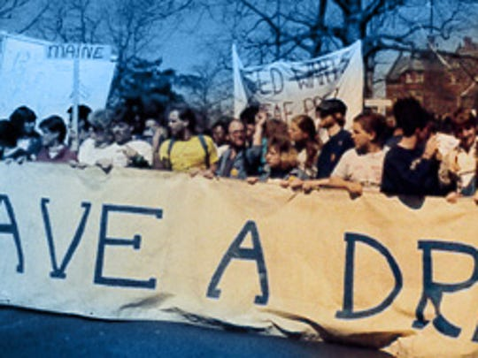 "Gallaudet University students  march during ""Deaf President"