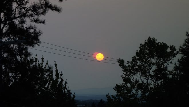 Hazy skies and a reddish cast to the morning sun in Salem.