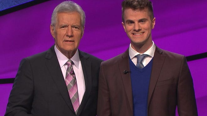 "Louis Virtel poses with Alex Trebek while a contestant on ""Jeopardy!"""