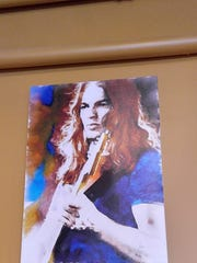 This painting of Pink Floyd guitarist David Gilmour was taken from the Holy Hound Taproom in York on Saturday morning, owner Scott Eden said.