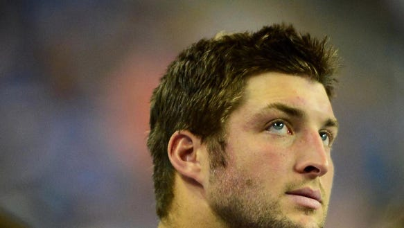 New England Patriots quarterback Tim Tebow (5) on the
