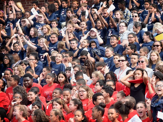 Students from every school in the city filled Alumni Stadium for the first The Great Lebanon Community Project. Students cheered, listened to speeches, released butterflies and sang. The event is meant to bring attention to community service and environmental concerns.