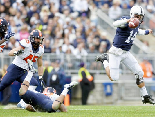 Penn State quarterback Christian Hackenberg (14) leaps past Illinois linebacker T.J. Neal (52) during the first half of Saturday's game at Beaver Stadium. Penn State swept Illinois, 39-0, in what is arguably Hackenberg's best performance of the season. He finished 21-of-29 for 266 passing yards and a pair of scores.