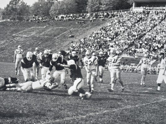Red Lion running back Danny Smith dives for an extra yard during the 1965 season at Horn Field. Smith signed with the Boston Red Sox after being drafted in the seventh round of the 1966 amateur draft.