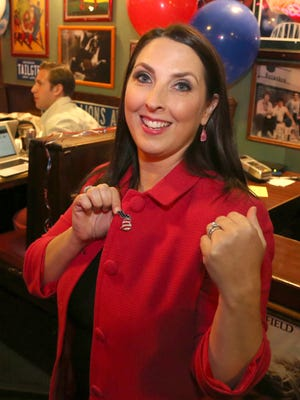 Michigan Republican Party Chairwoman Ronna Romney McDaniel shows off the Michigan lapel pin with American flag colors at the Heroes Bar-BQ and Brew in Waterford, on November 8, 2016. Romney-McDaniel came to the restaurant for the GOP Watch Party.