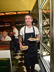 Chef Michael Solomonov serves guest sandwiches at his restaurant Abe Fisher in Philadelphia.