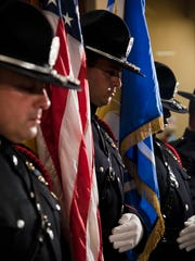 Police officers stood in a moment of silence at Metro Hall in Louisville on Friday, July 8, in honor of the five police officers who lost their lives in Dallas yesterday.