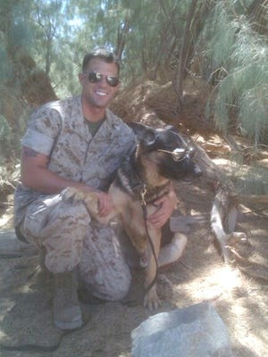 Jeremy Angenend and his combat dog, Fito, in Twentynine Palms, Calif., just before they deployed to Afghanistan in 2010.