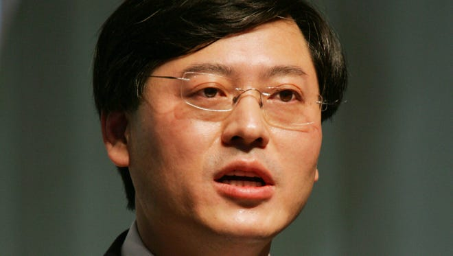 Yang Yuanqing, chairman of Lenovo Group Ltd., delivers a speech during the 7th Nikkei Global Management Forum in Tokyo.