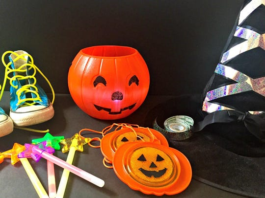 Reflectors, tape, glow sticks and small flashlights in the buckets will help keep your trick-or-treaters visible in the night.