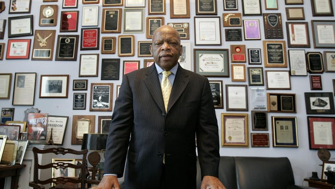 CORRECTS POLITICAL PARTY FROM REPUBLICAN TO DEMOCRAT - FILE - In this Thursday, May 10, 2007 file photo, U.S. Rep. John Lewis, D-Ga., in his office on Capitol Hill, in Washington. Lewis, who carried the struggle against racial discrimination from Southern battlegrounds of the 1960s to the halls of Congress, died Friday, July 17, 2020.