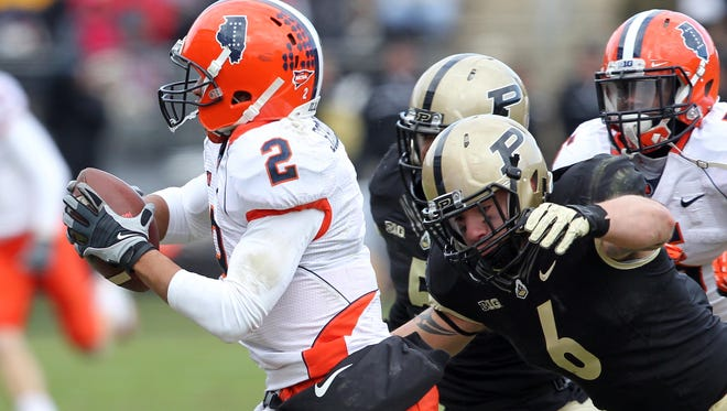 Nov 23, 2013: Purdue Boilermakers running back Jonathan Curry (2) is chased down by Purdue Boilermakers linebacker Ruben Ibarra (6) during the third quarter at Ross Ade Stadium. Illinois won 20-16.