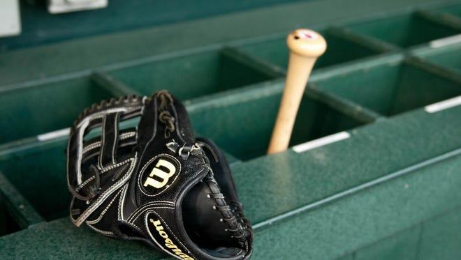 A baseball bat and glove.