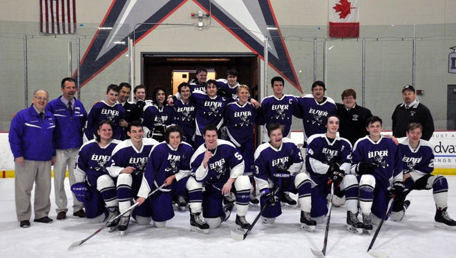 Elder High School's hockey celebrates the second playoff win in school history, 4-3 over Moeller, on Feb. 18 at the Ice Haus in Columbus.