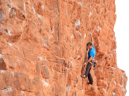 Todd Perkins climbs along the Chuckwalla Wall in St. George on April 6. More than 30 routes have been established at this popular climbing spot.