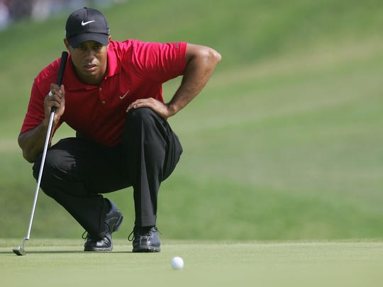 SAN DIEGO - JUNE 16:  Tiger Woods lines up a putt on the fourth hole during the playoff round of the 108th U.S. Open at the Torrey Pines Golf Course (South Course) on June 16, 2008 in San Diego, California.  (Photo by Jeff Gross/Getty Images)